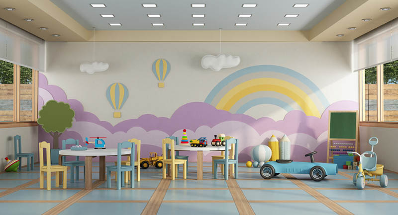 buntes Interieur des Kindergartenzimmers mit Kinderspielzeug