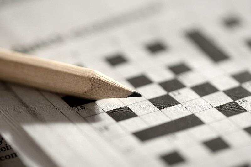 ein Kreuzworträtsel und einen Bleistift